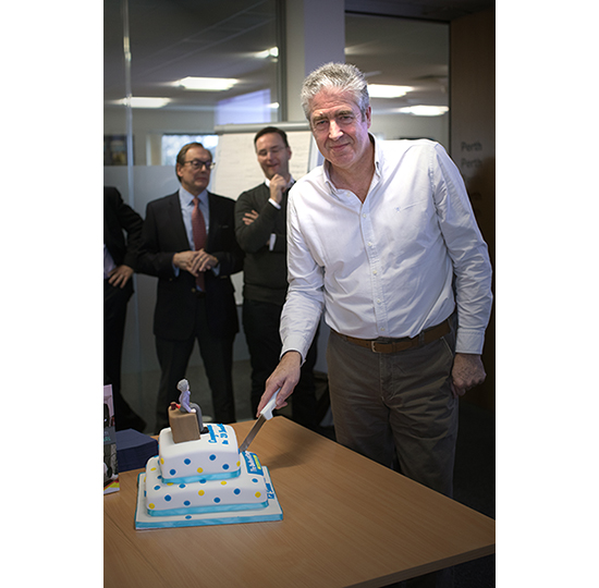 Karl cuts cake
